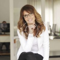 Clean modern portrait of a mature professional business woman with ample copyspace.