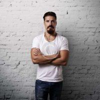 Bearded handsome man wearing white t-shirt